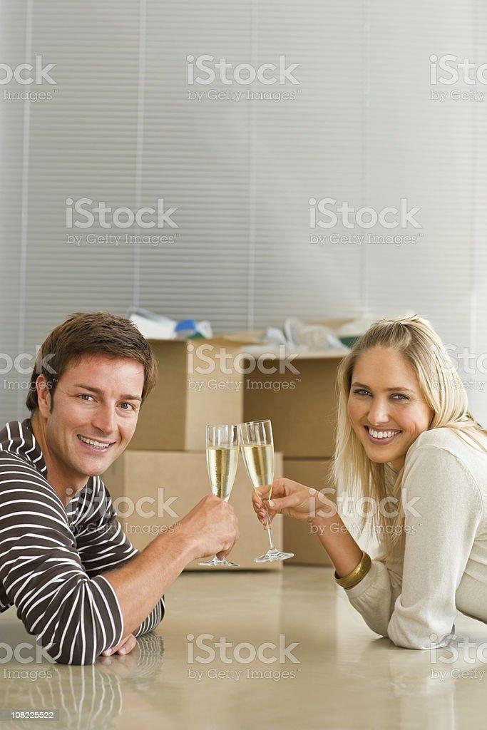 Happy young couple having toast royalty-free stock photo