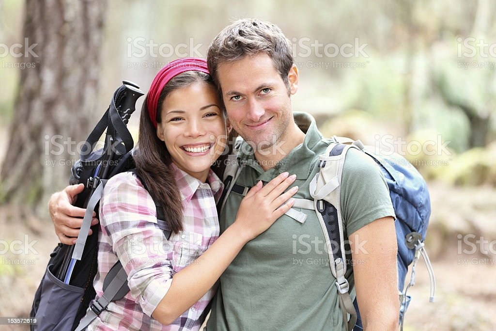 Happy young couple hiking royalty-free stock photo