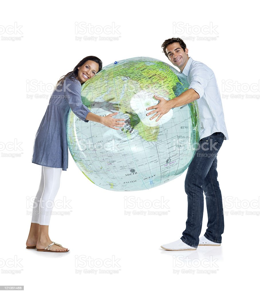 Happy young couple holding a globe on white royalty-free stock photo