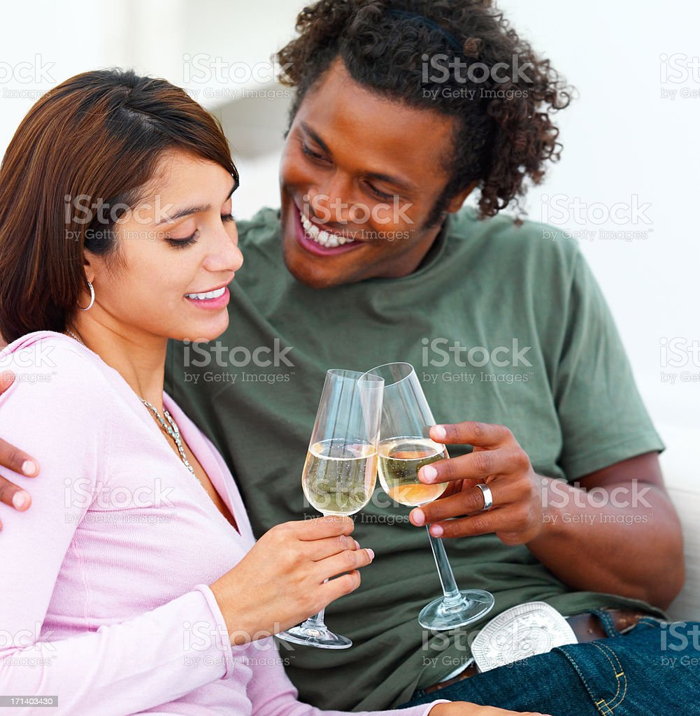 Happy young couple holding champagne glasses royalty-free stock photo