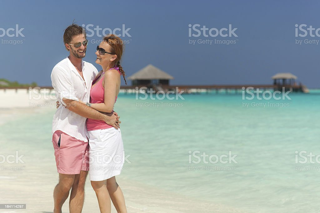happy young couple hugging on the beach royalty-free stock photo
