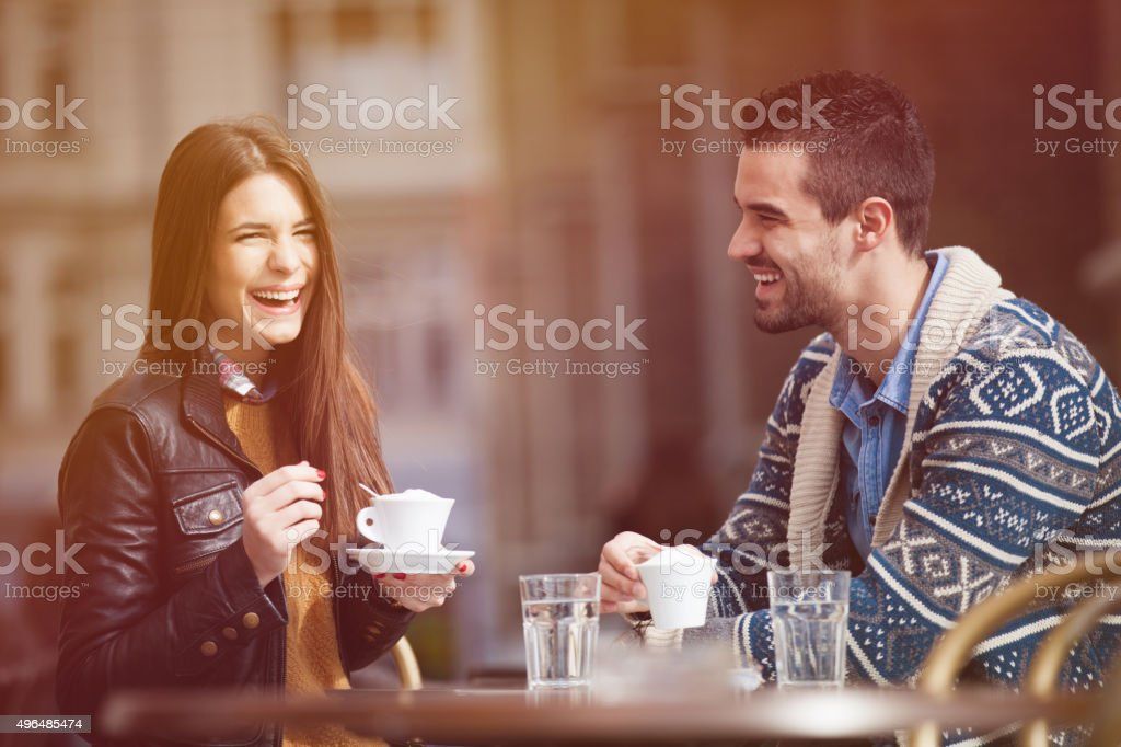 Happy young couple in a cafe stock photo