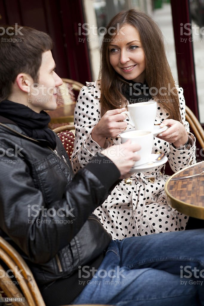 Happy young couple in a Parisian Street cafe royalty-free stock photo