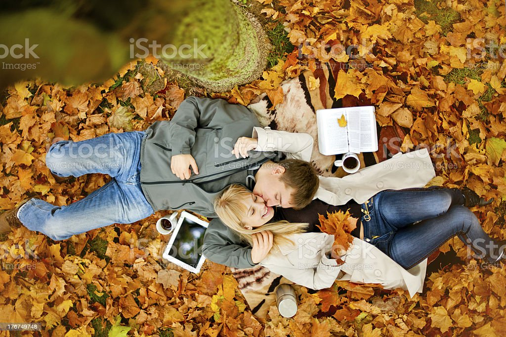 Happy young couple in autumn park royalty-free stock photo