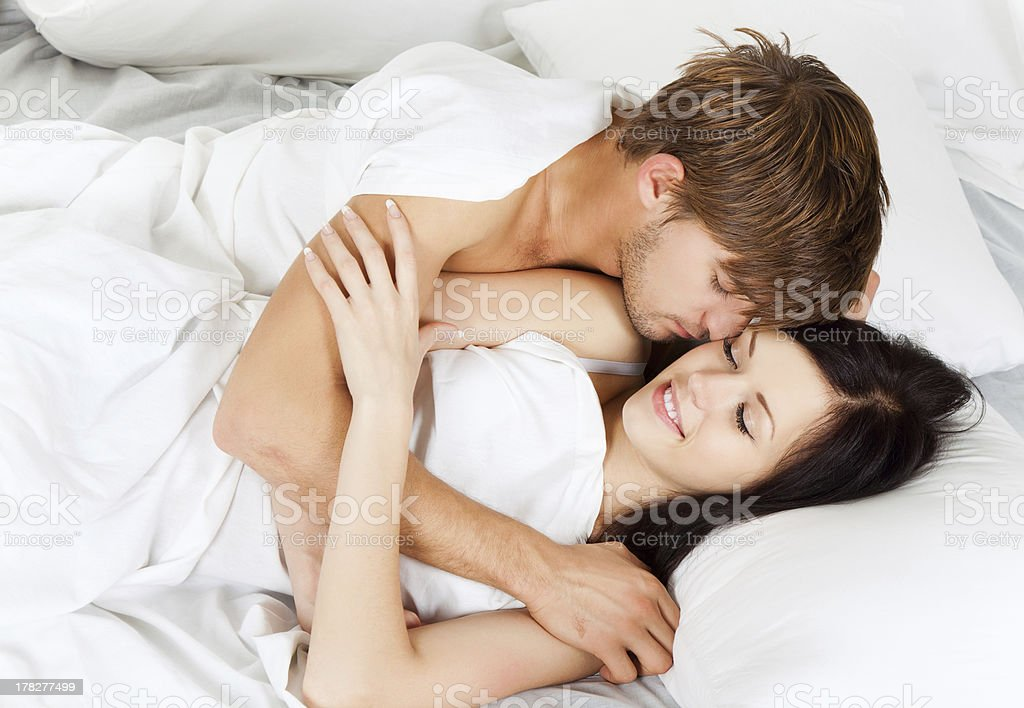happy young couple in bed stock photo