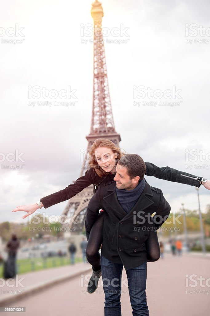 Happy young couple in Paris stock photo