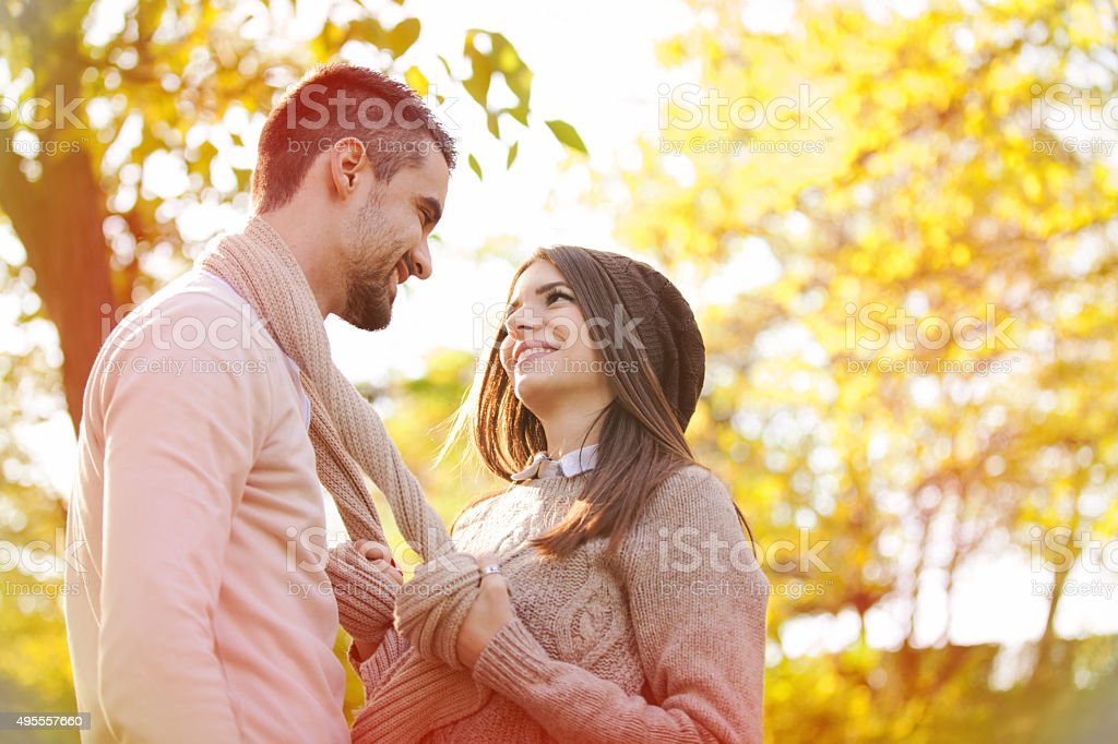Happy young couple in the park stock photo