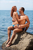 Happy young couple in the sea