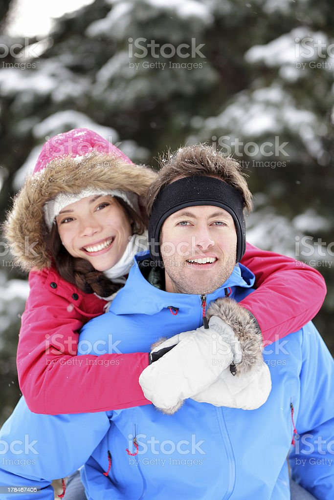 Happy young couple in winter royalty-free stock photo