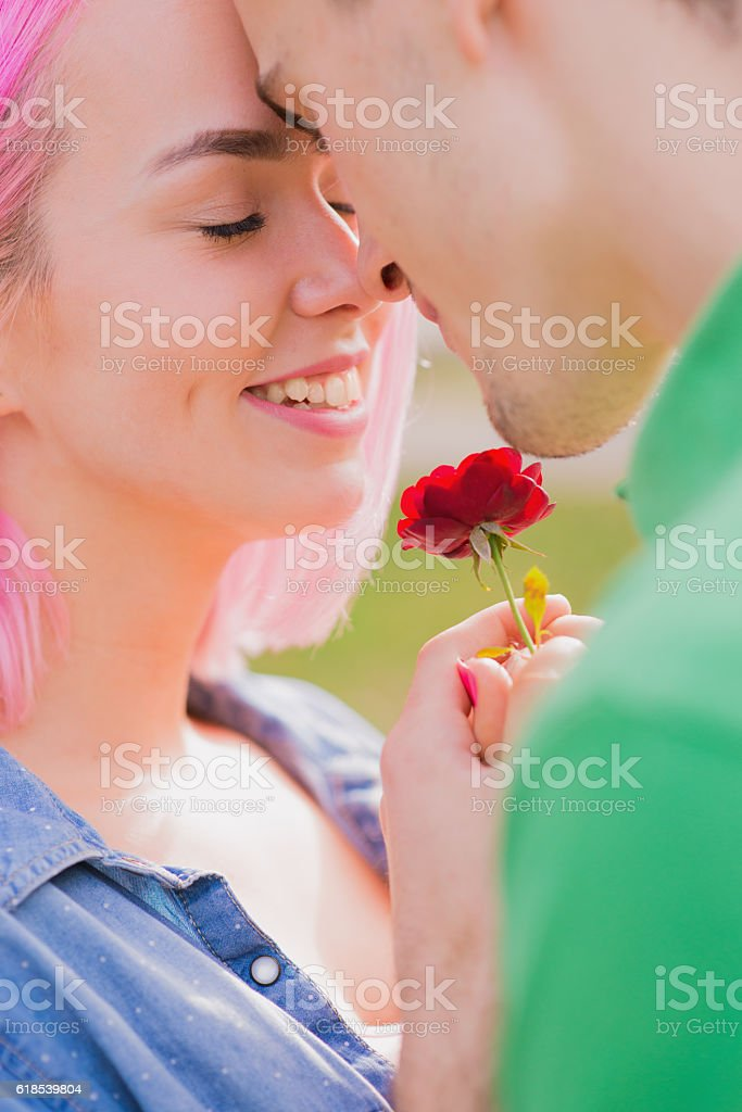 happy young couple kissing outdoor in the park stock photo