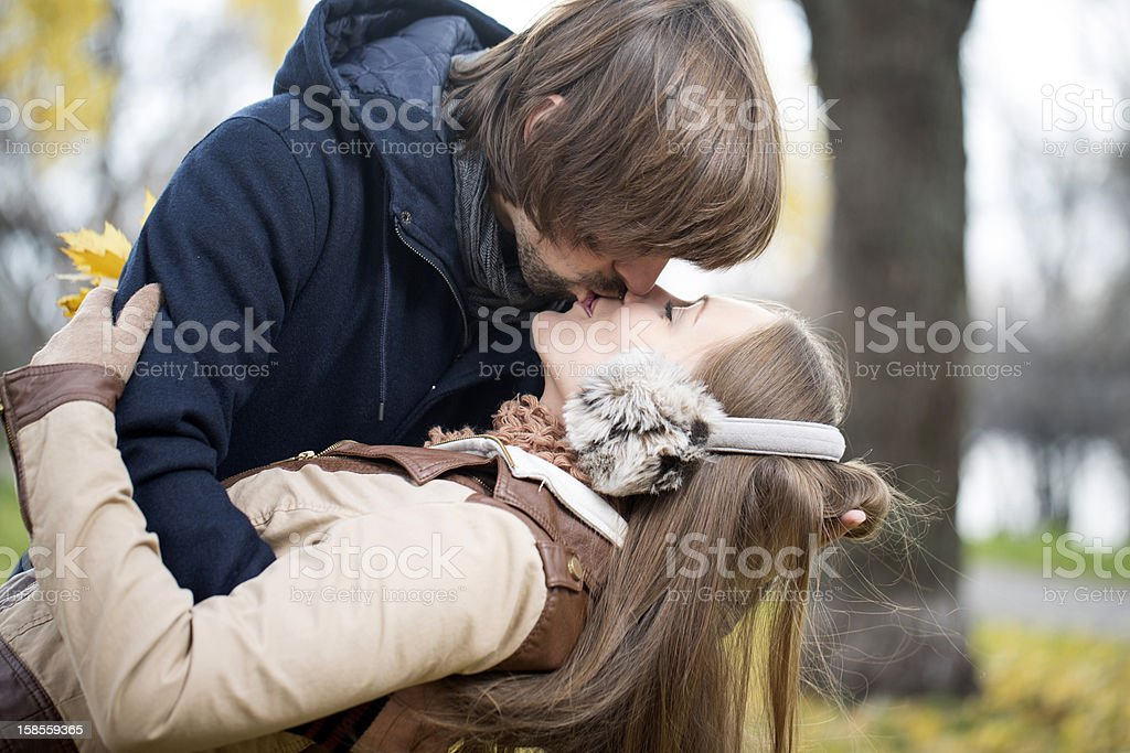 Happy young couple kissing outdoor stock photo