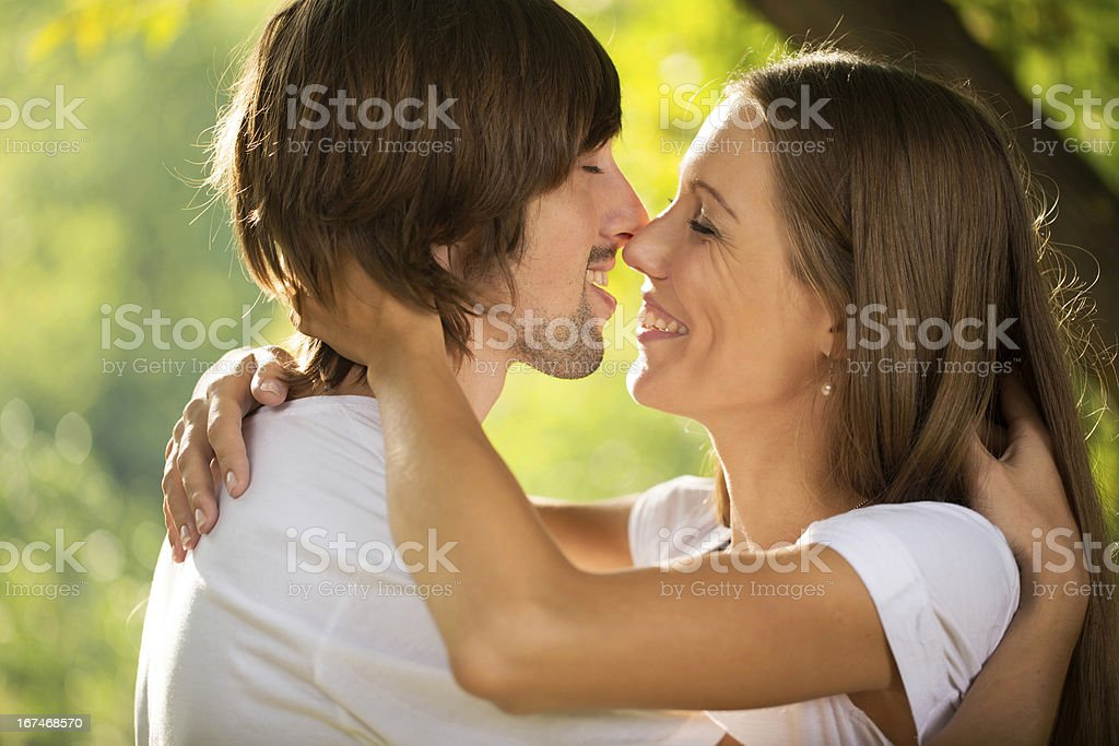 happy young couple kissing outdoor royalty-free stock photo
