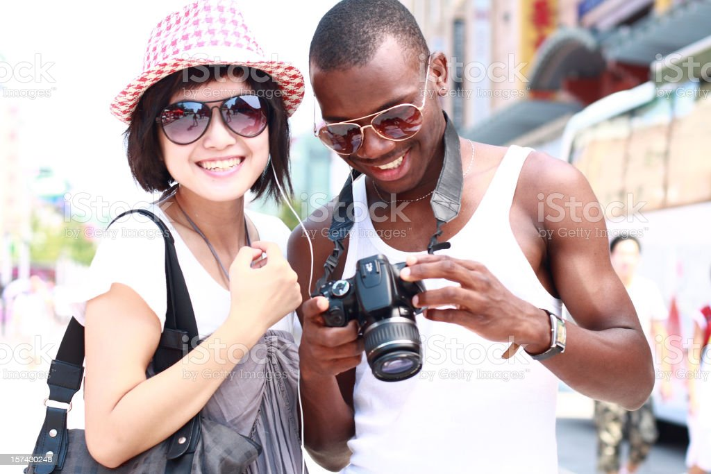 happy young couple looking at their camera royalty-free stock photo