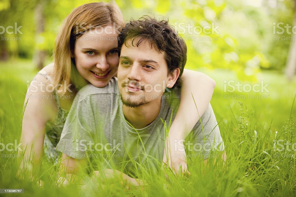 Happy Young Couple lying in grass royalty-free stock photo