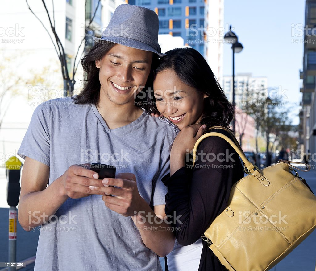 happy young couple on mobile phone royalty-free stock photo