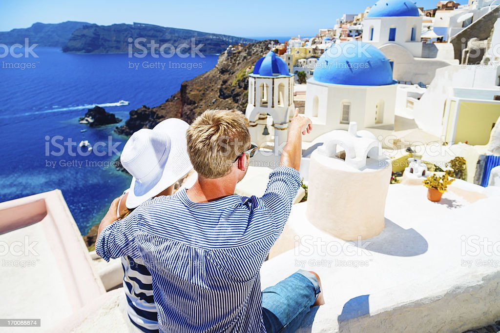 Happy young couple on Santorini island, Greece stock photo