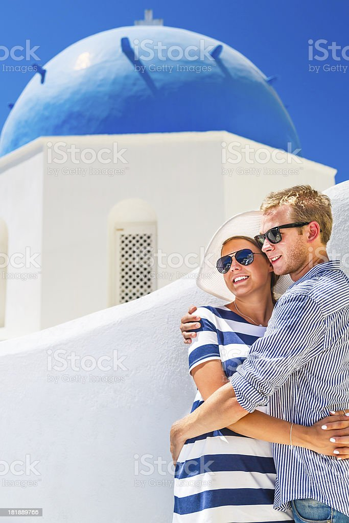 Happy young couple on Santorini island, Greece royalty-free stock photo