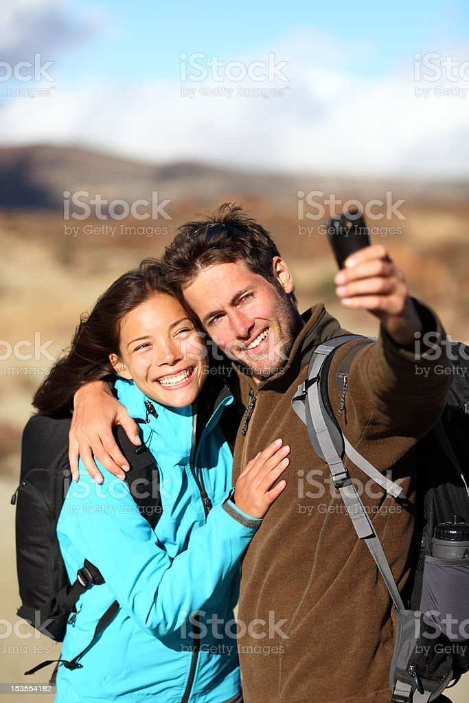 Happy young couple outdoors hiking royalty-free stock photo
