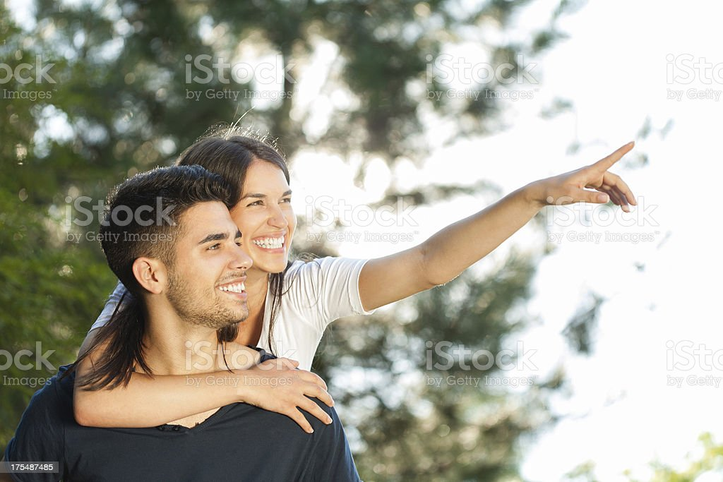 Happy young couple outdoors stock photo