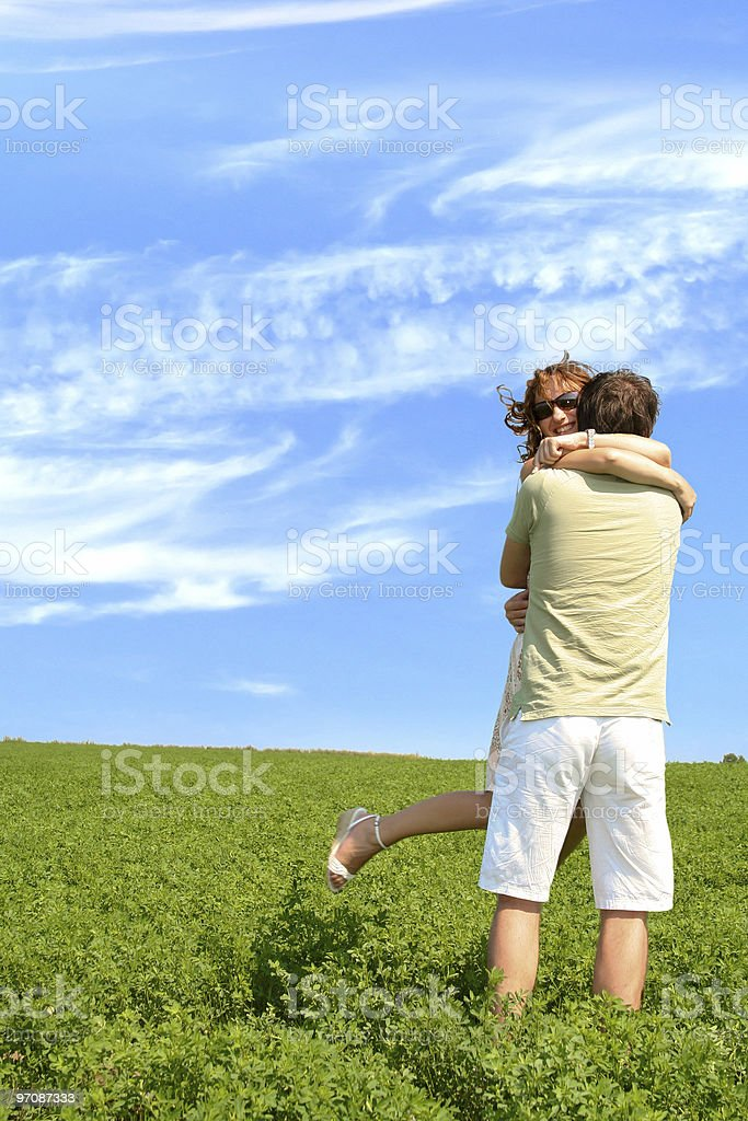 Happy young couple outside on a field royalty-free stock photo