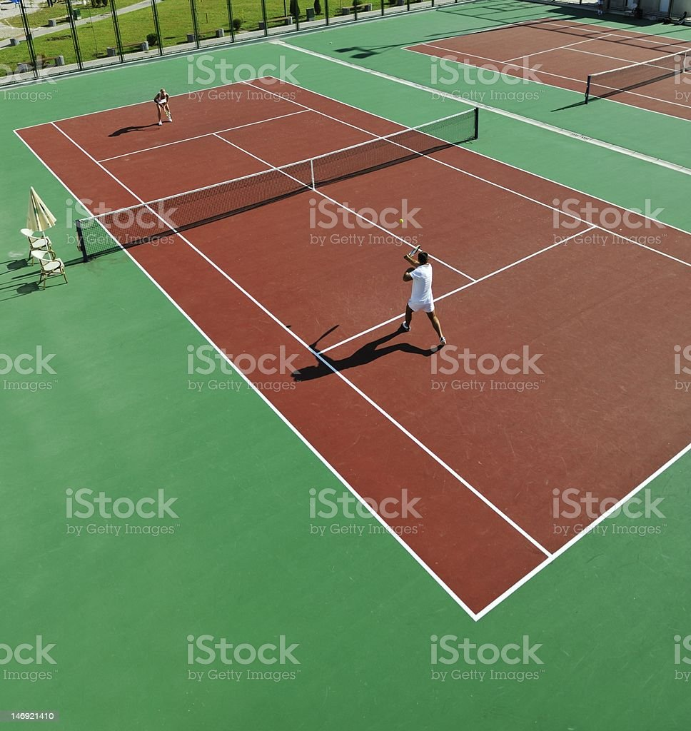 happy young couple play tennis game outdoor royalty-free stock photo