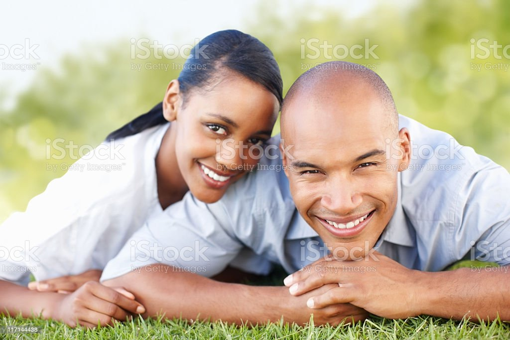 Happy, young couple relaxing outdoors royalty-free stock photo