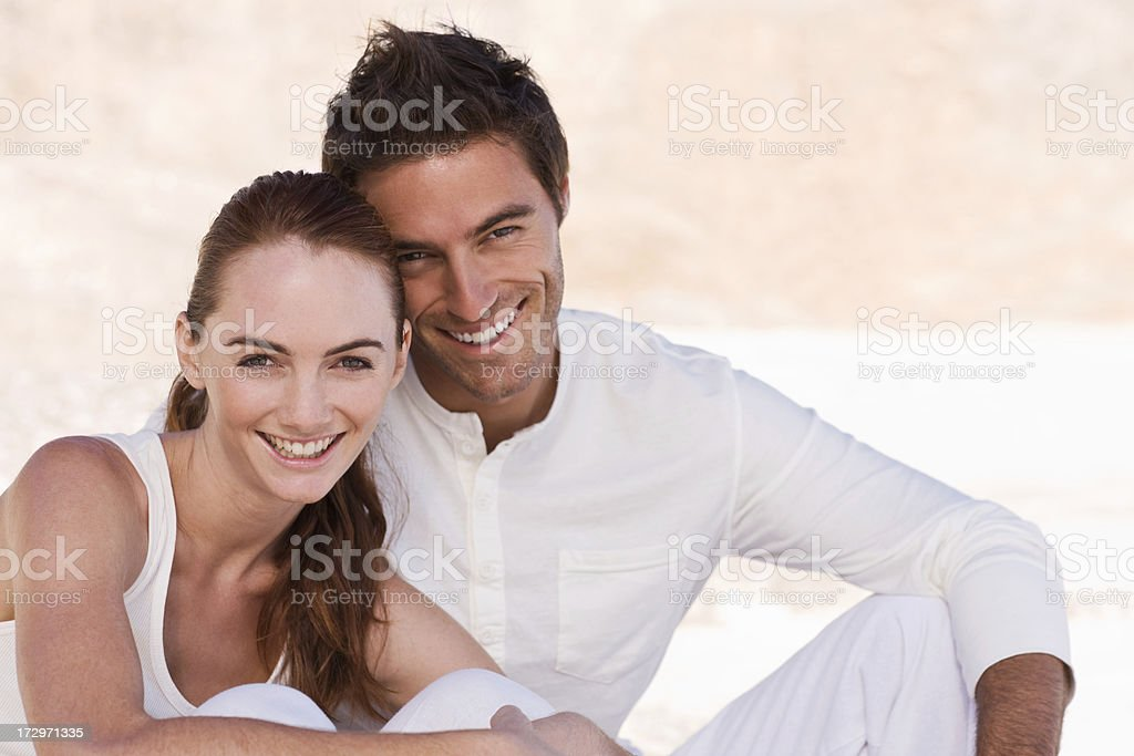 Happy young couple smiling royalty-free stock photo