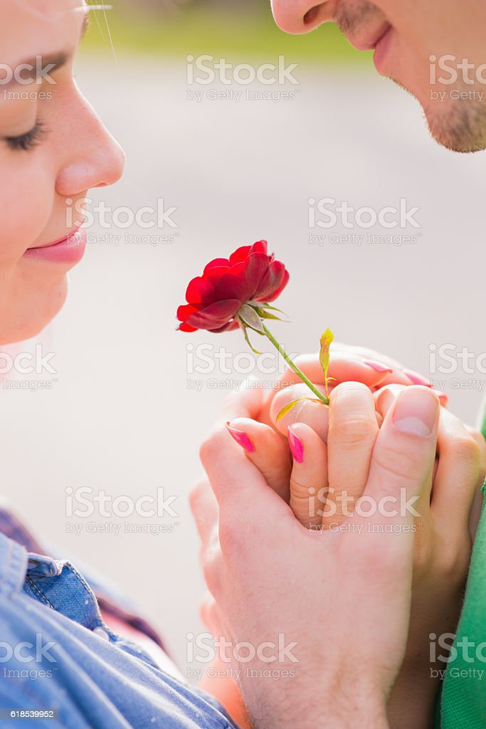 happy young couple spending time outdoor in the autumn park stock photo