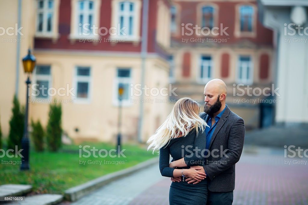 happy young couple standing in embrace blonde with beautiful hair royalty-free stock photo