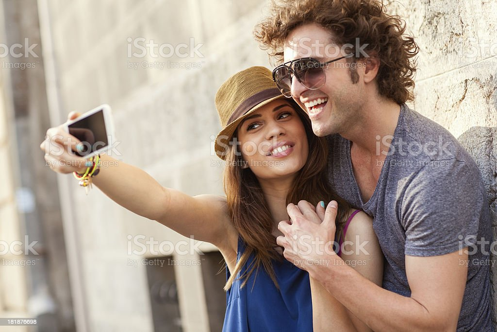 Happy young couple taking photo of themselves royalty-free stock photo