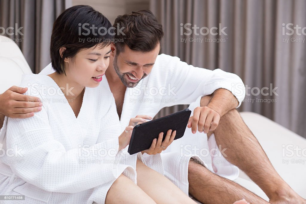 Happy Young Couple Using Tablet in Spa Salon stock photo