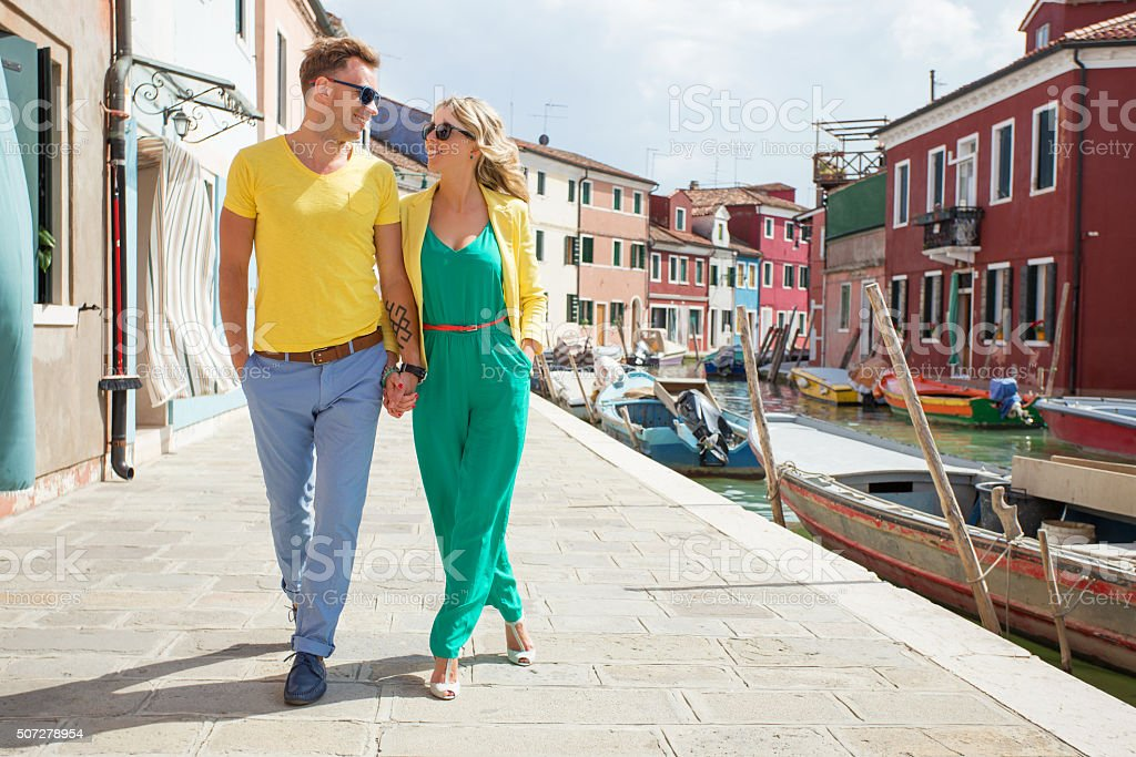 Happy young couple walking in romantic village stock photo