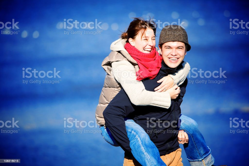 Happy young couple walking near the sea royalty-free stock photo