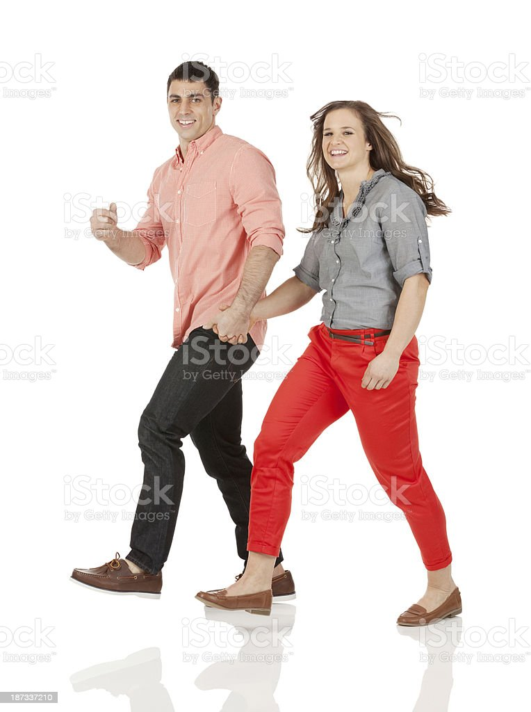 Happy young couple walking royalty-free stock photo