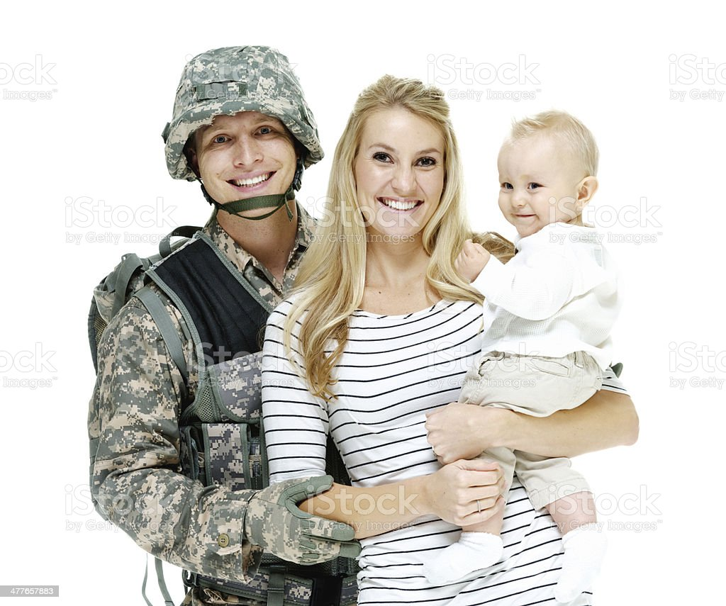 Happy young couple with their baby royalty-free stock photo