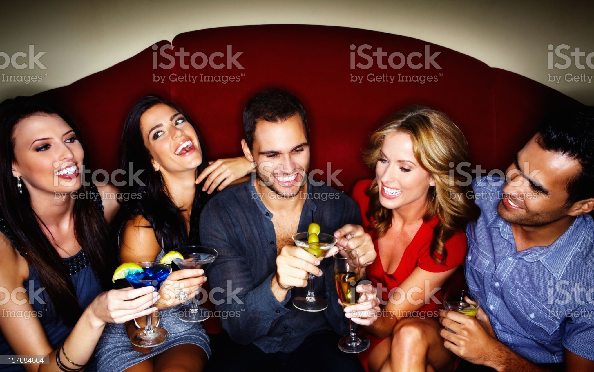 Happy young couples enjoying drinks at a nightclub royalty-free stock photo
