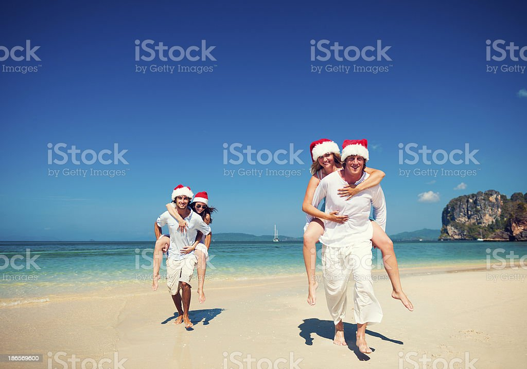 Happy young couples having fun on the beach royalty-free stock photo