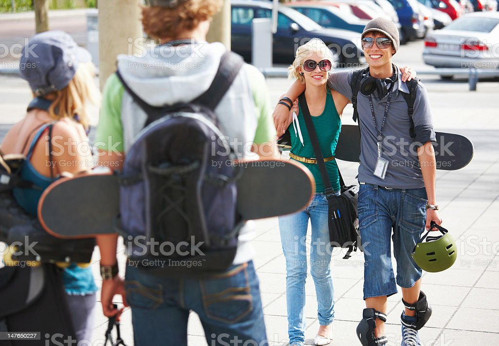 Happy young couples walking together on street royalty-free stock photo