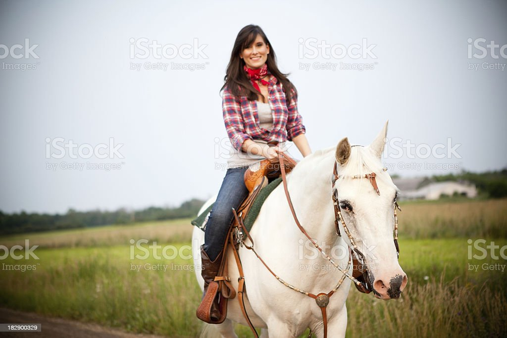Happy, Young Cowgirl Riding Horse Outside royalty-free stock photo