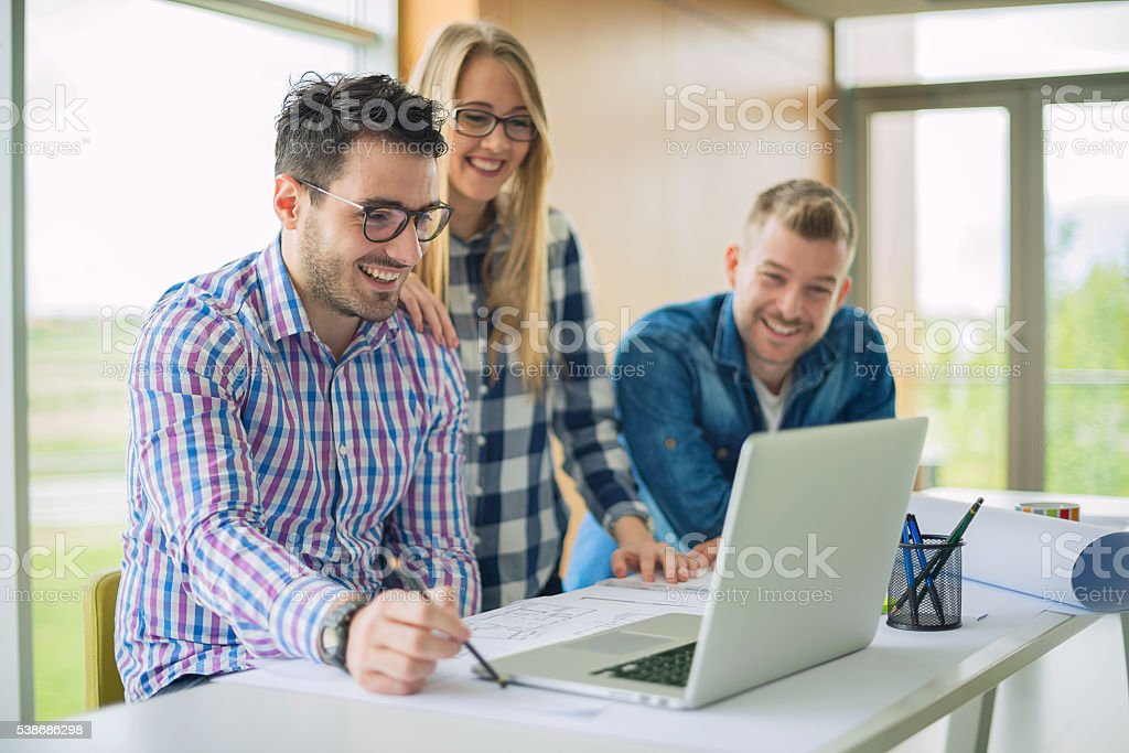 Happy young designers stock photo