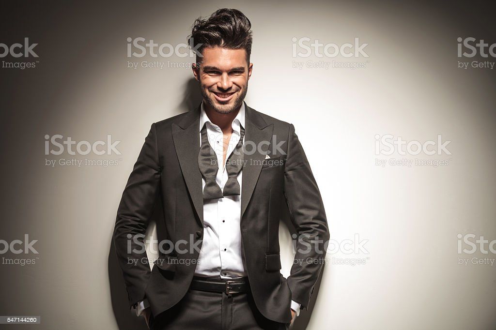 Happy young elegant business man smiling stock photo