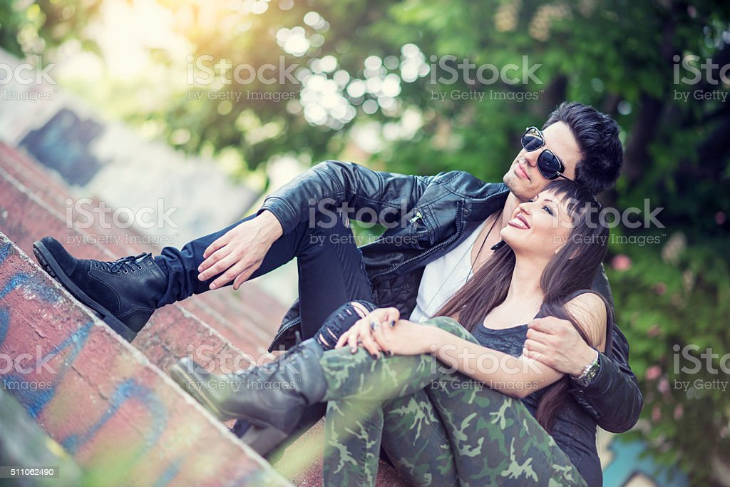 Happy Young Embraced Hipster Couple Enjoying City Life stock photo