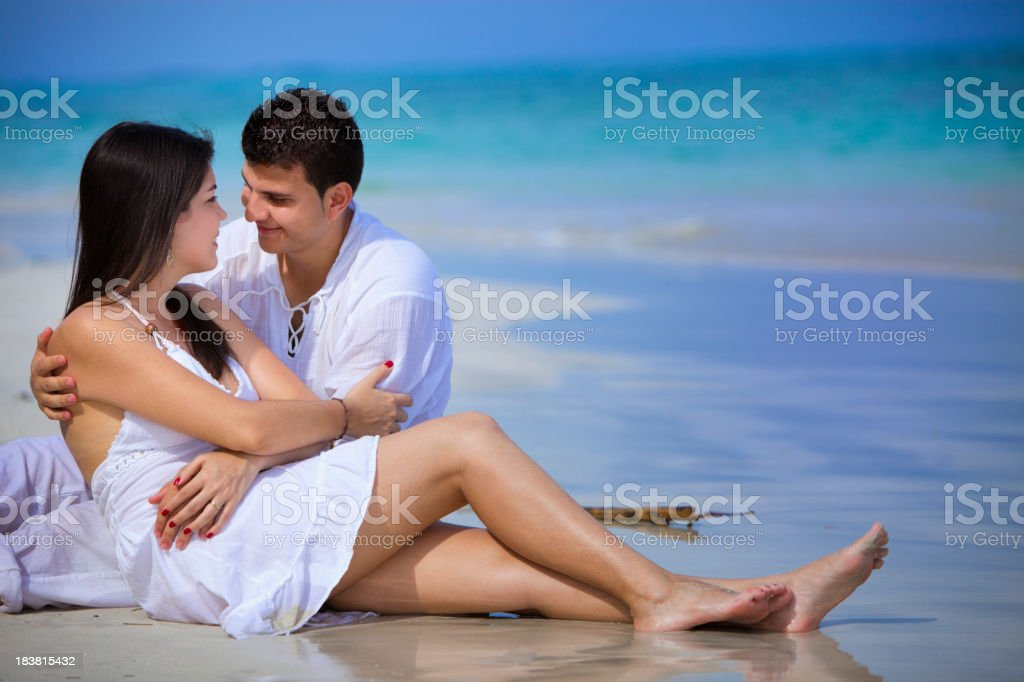 Happy young engaged couple on a tropical beach royalty-free stock photo
