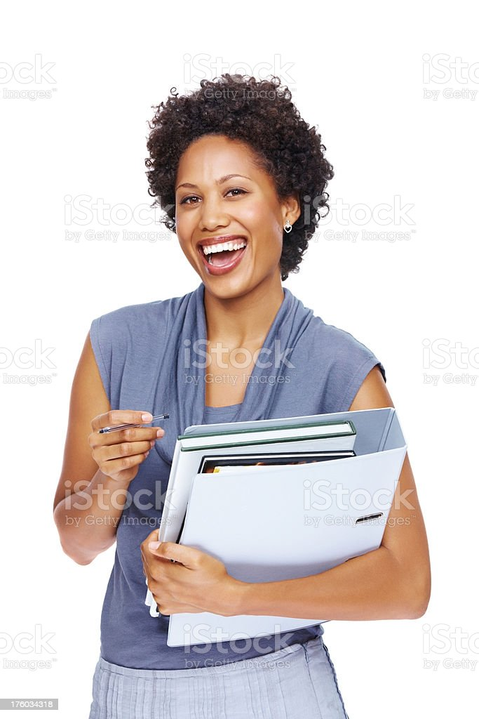 Happy young executive holding files standing on white stock photo