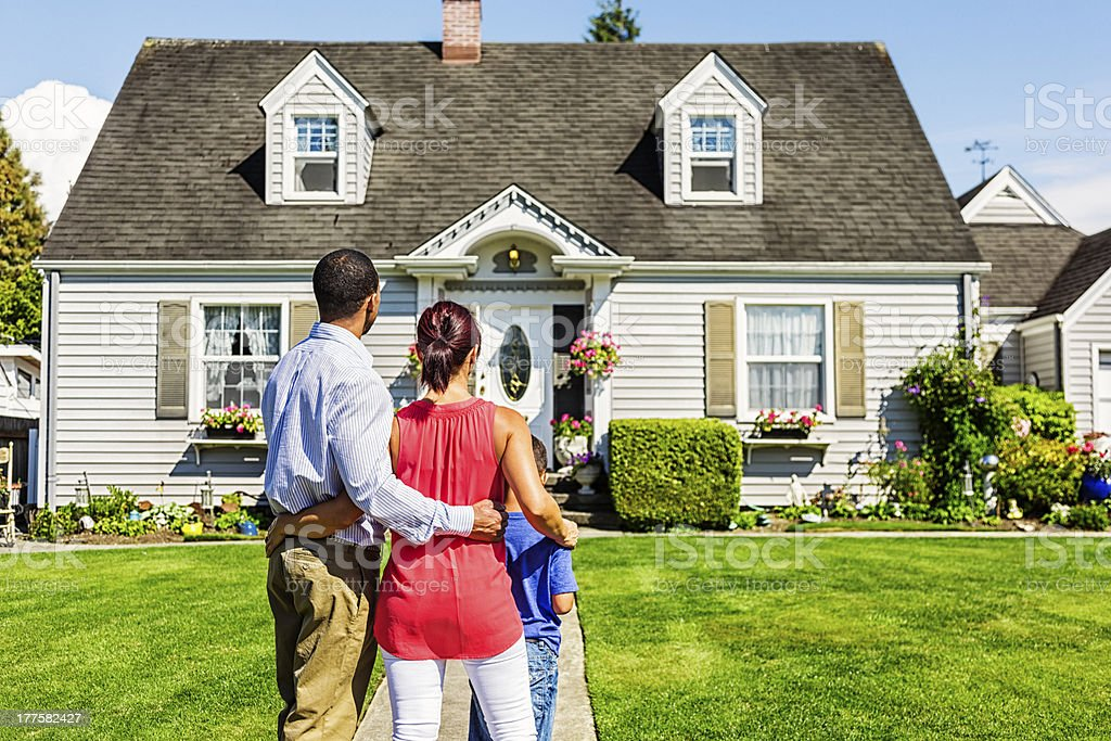 Happy Young Family Admiring Home stock photo