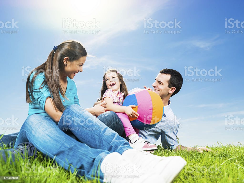 Happy young family against the clear sky. royalty-free stock photo