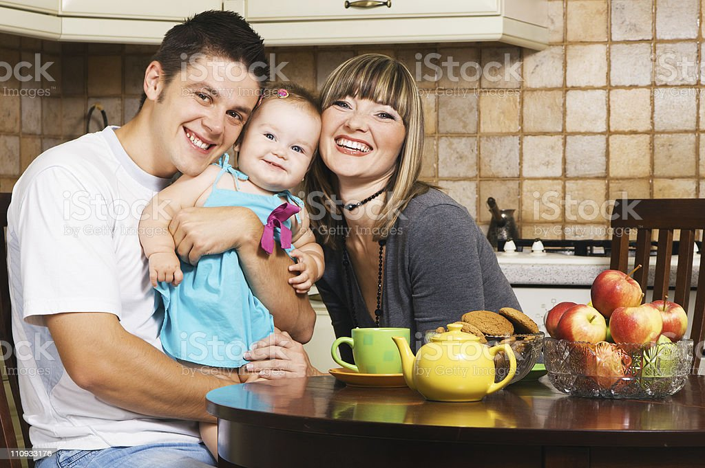 Happy young family at home royalty-free stock photo