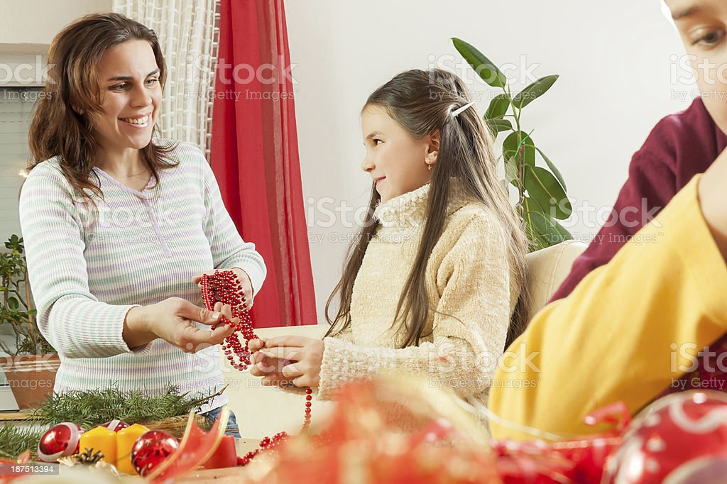 Happy young family getting ready for the Advent, Christmas holidays royalty-free stock photo