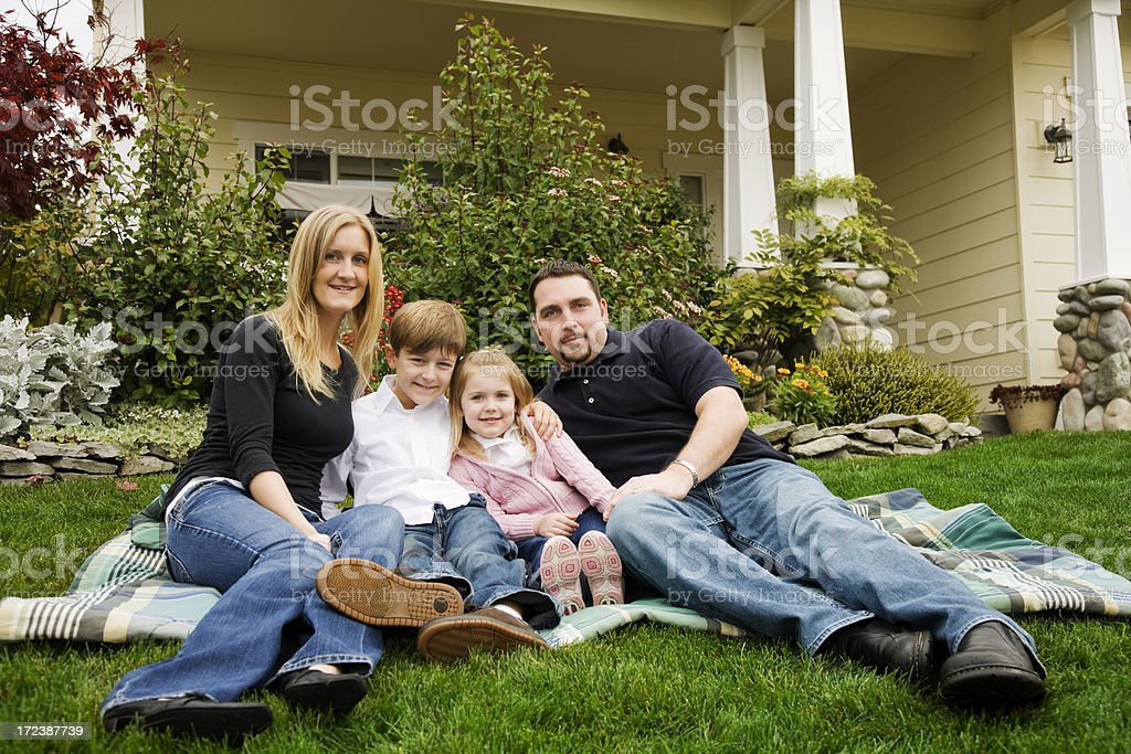 Happy Young Family in Front Yard royalty-free stock photo