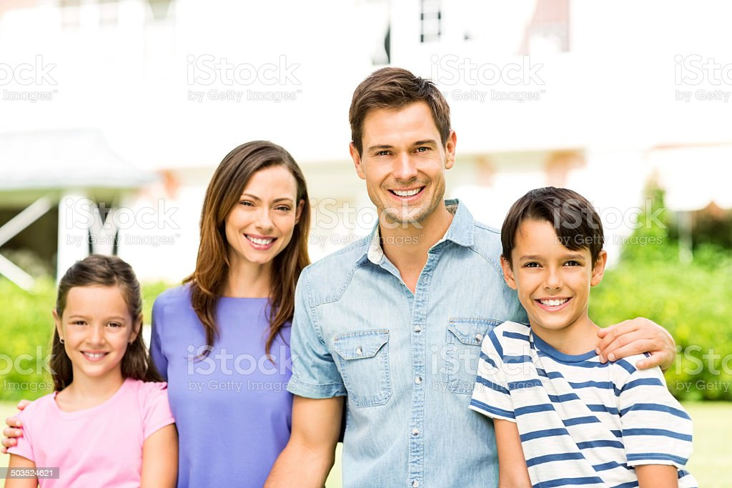 Happy Young Family In Garden royalty-free stock photo